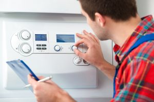 26703867 - technician servicing the gas boiler for hot water and heating